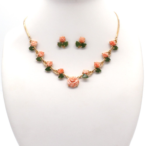 Swirled pink and white coral flowers, genuine jade leaves on a gold plated chain