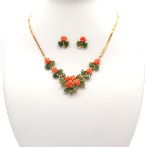 Necklace and earrings with Momo coral rosebuds and genuine jade leaves with a gold plated chain