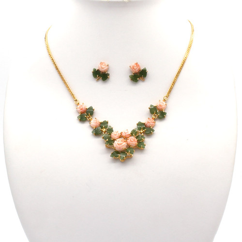 Necklace and earrings with coral flowers on a gold chain