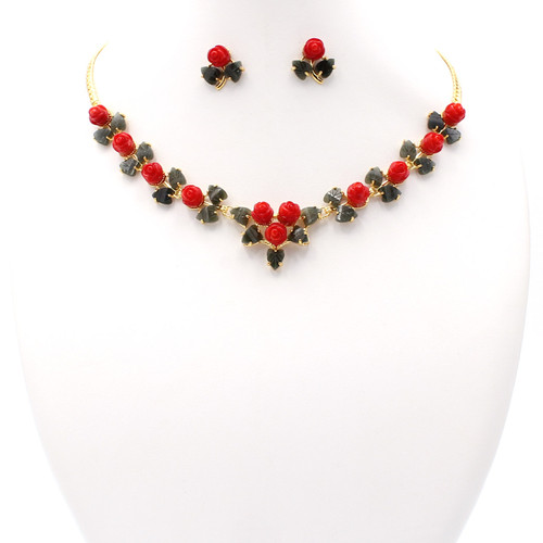 Dyed red coral roses with dark green jade leaves and gold chain, necklace and earrings