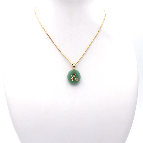 Green aventurine pendant with gold flower on gold chain necklace