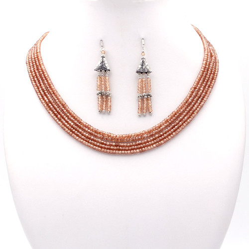 Light pink faceted cubic zirconia bead necklace and earrings with tassel