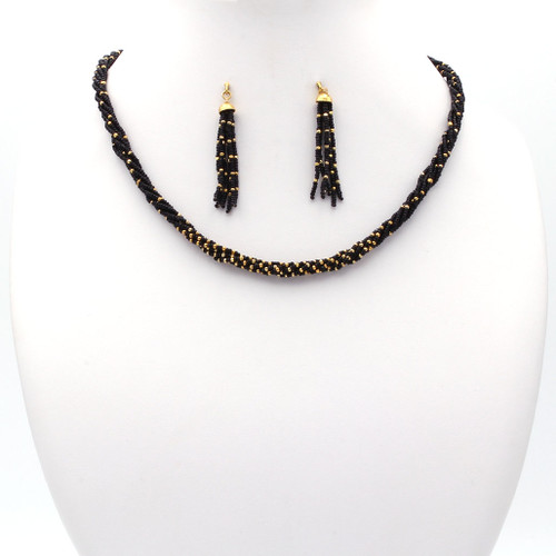 Black Czech bead and 22k gold necklace and earrings set with tassel