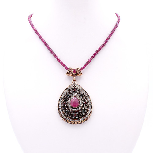 Natural smooth ruby bead necklace with gem encrusted teardrop pendant