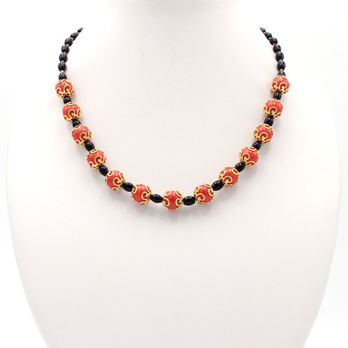 Round coral-colored beads with black onyx and 22k gold beads