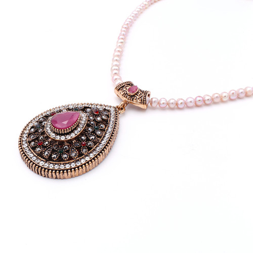 Pink button freshwater pearl necklace with gem encrusted pendant