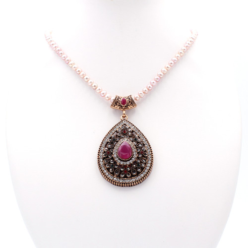 Pink freshwater pearl necklace with red teardrop pendant