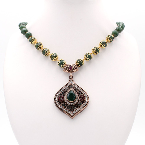 Round jade bead necklace with 22k gold and gem encrusted pendant
