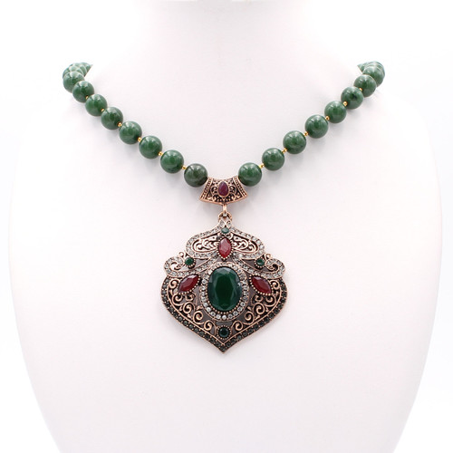Smooth round natural jade and 22k gold necklace with pendant