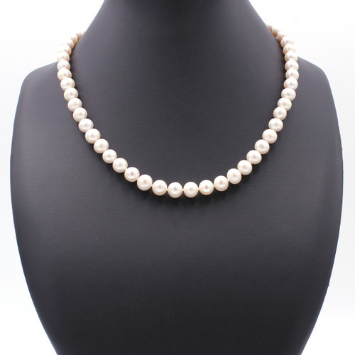 Knotted large round freshwater pearl necklace