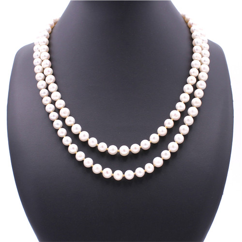 Two strand round white pearl necklace with 22k gold