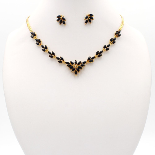 Black onyx and gold necklace, earrings, and bracelet set