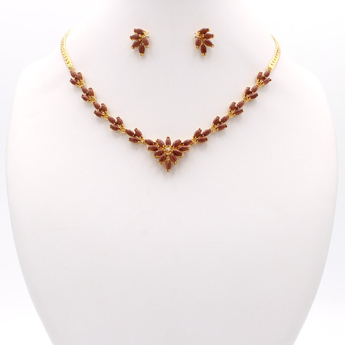Matching necklace earrings and bracelet with goldstone and cubic zirconia