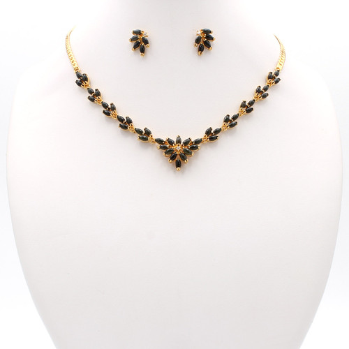 Gold necklace and earrings with cubic zirconia and dark jade