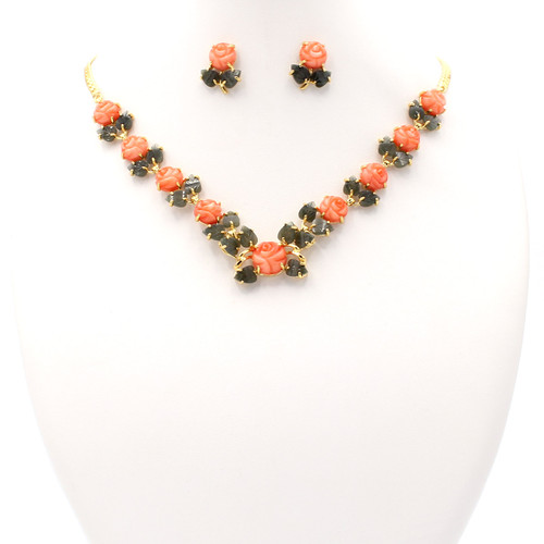 Hand-carved pink coral and jade matching necklace and earrings set