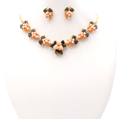 Matching necklace and earring set of pink coral, jade, and 22k gold
