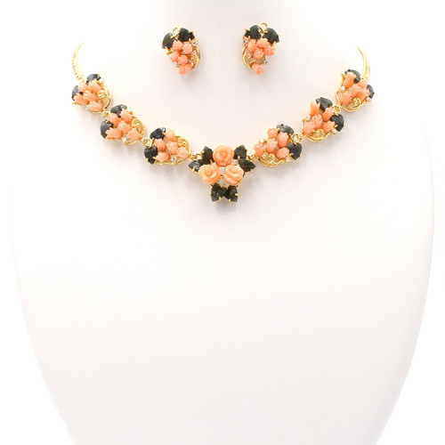 Matching necklace and earrings set of coral, jade, and real gold