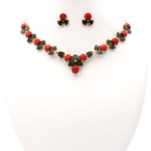 Matching gold necklace and earrings set with dark red coral roses and jade leaves