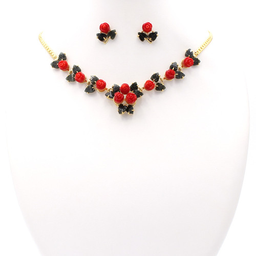 Matching necklace and earrings made of coral, jade, and 22k gold