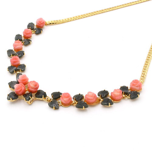 bright pink dyed coral roses and natural jade leaves in a gold plated setting, necklace