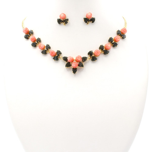 Matching necklace and earrings made of pink coral, jade, and 22k gold