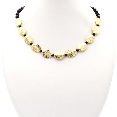 Natural round black onyx and gold flat beads with flowers