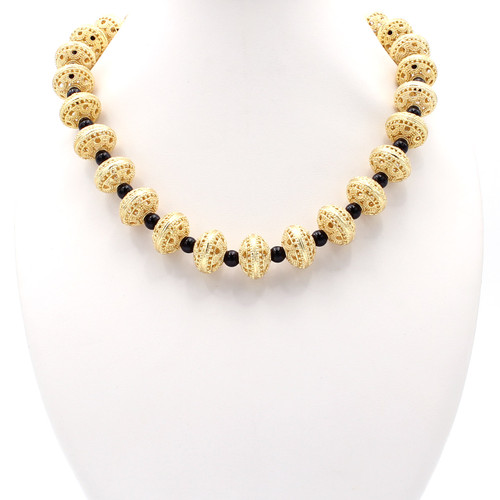 Round black onyx golden copper bead necklace at Abson Inc.