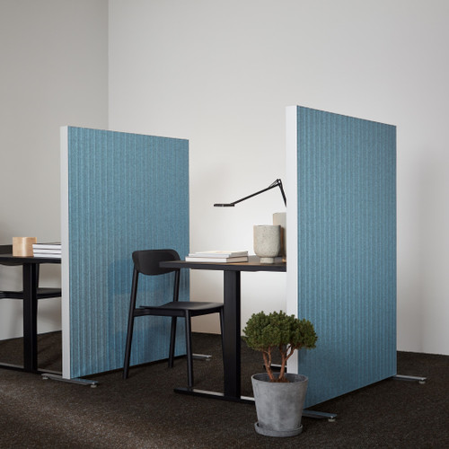 The Alumi acoustic screen adds a playful touch to space partitioning - vertical lines blue panels - side view - in office.