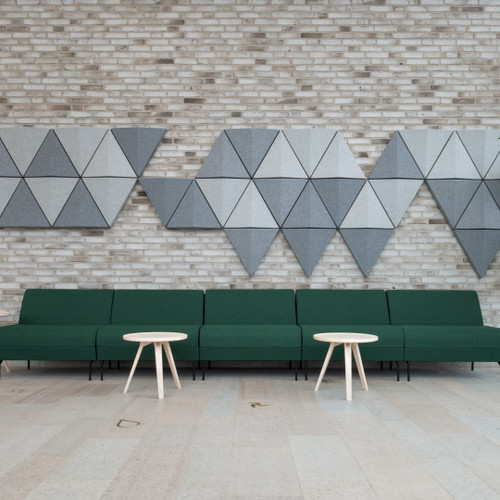 The Bits Wall by Abstracta transforma style into an acoustic formula for noise absorption and echo prevention  -  light and dark grey panels - front view - in office.