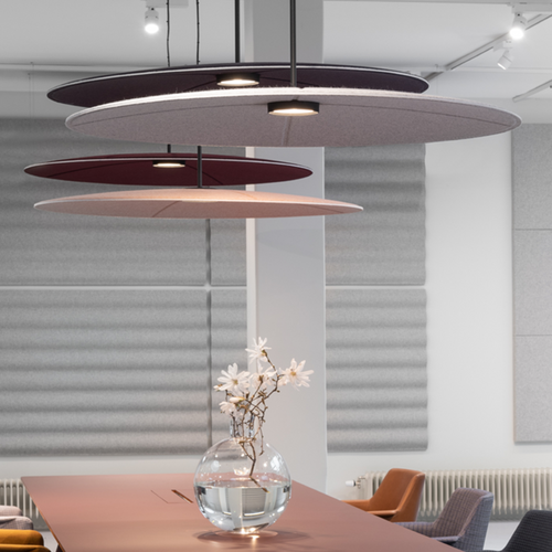 Abstracta Lily Acoustic Lamp and Sound Absorber with a dimmable LED light in the shape of lily water flowers - with lightning - white core - dark red, light pink, dark grey and light grey - side view - in office.