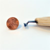 Flexcut 70° Right-Handed Scorp next to a penny comparing size of scorp end.