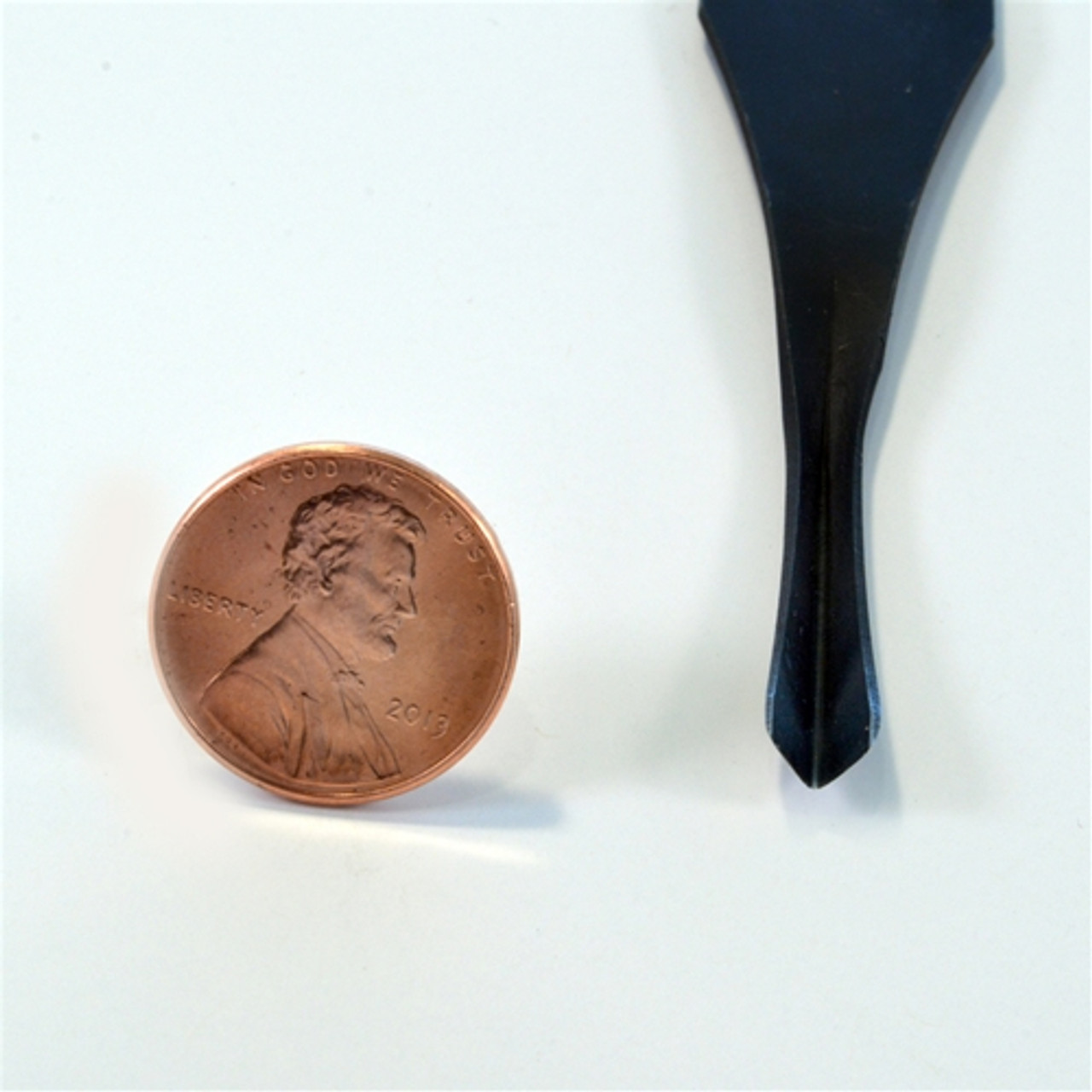 """The Flexcut FR307 Palm Carving V Tool shown in 70° angle with 1/4"""" wide blade in reference to penny in size."""