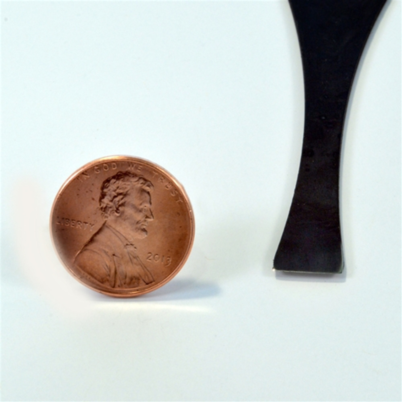 """Flexcut FR316 Palm Carving  #1 x 3/8"""" Chisel showing the size of the single bevel chisel compared to a penny."""
