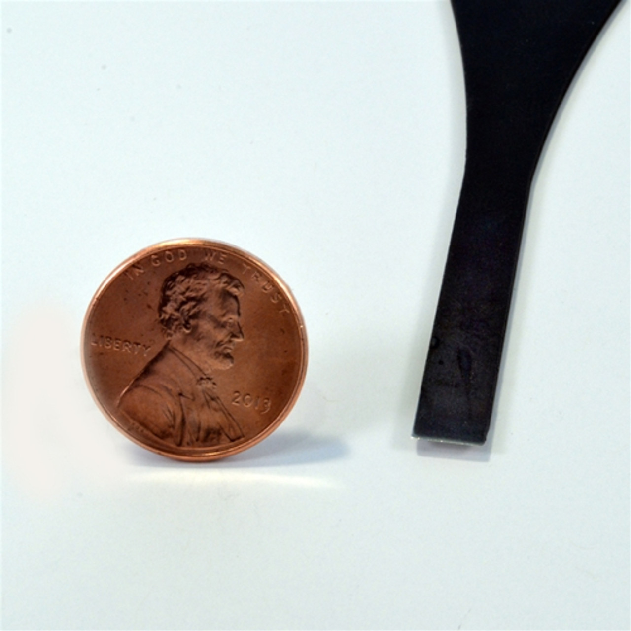 """Flexcut FR329 Palm Carving  #1 x 1/4"""" Chisel next to a penny to show the size of the chisel."""
