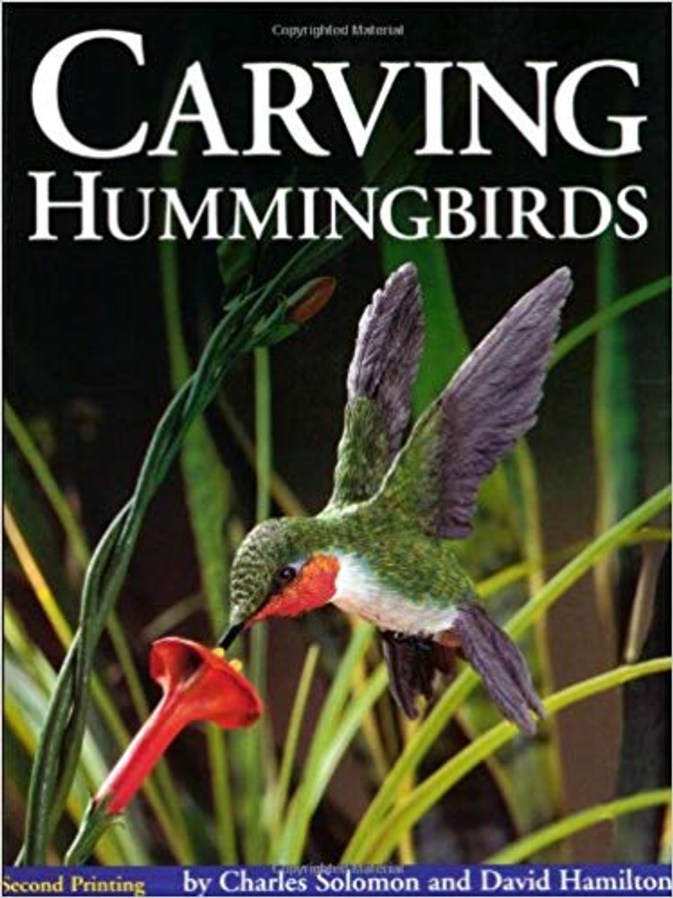 Carving Hummingbirds  showing a Hummingbird feeding from a flower.