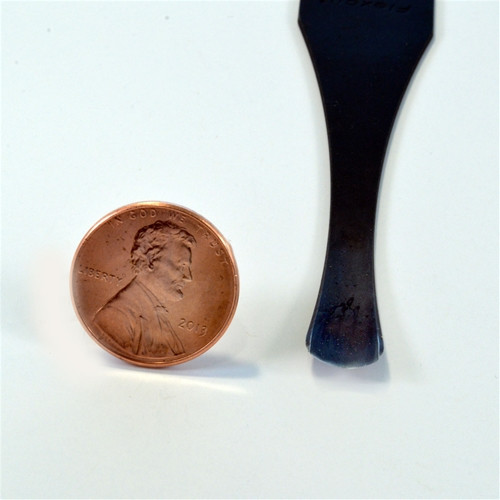 "Blade of the Flexcut FR306 Palm Carving Gouge that features a #6 sweep with a 5/16"" width.  Shown beside a penny for actual size."