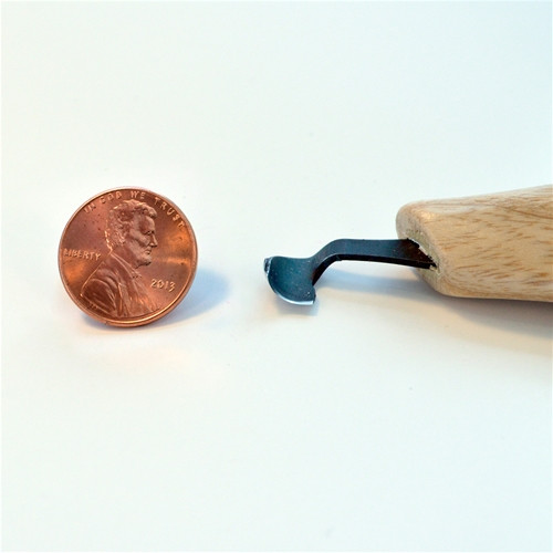 Flexcut KN23 Right-Handed Scorp next to a penny comparing size of scorp tip.