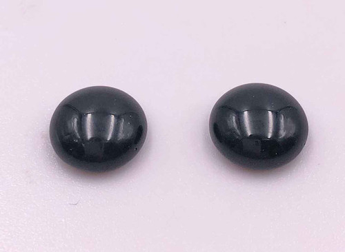 Black glass eyes top and side angle view of a pair of 12mm eyes.