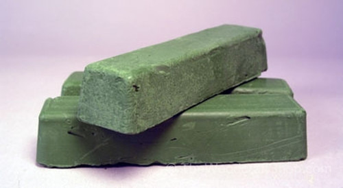 Three bars of the green honing compound stacked.