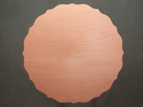 Basswood Scalloped flat plate showing the face of the plate.