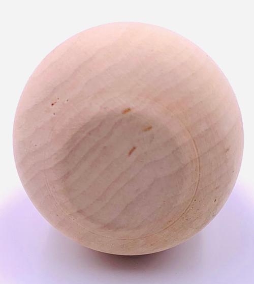 Basswood Apple  shown on it's side.