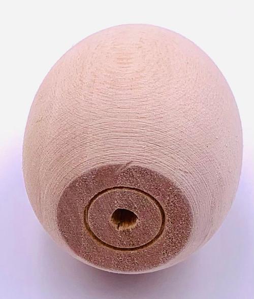 Basswood Pigeon Egg - 1 Dozen showing the bottom of the egg.