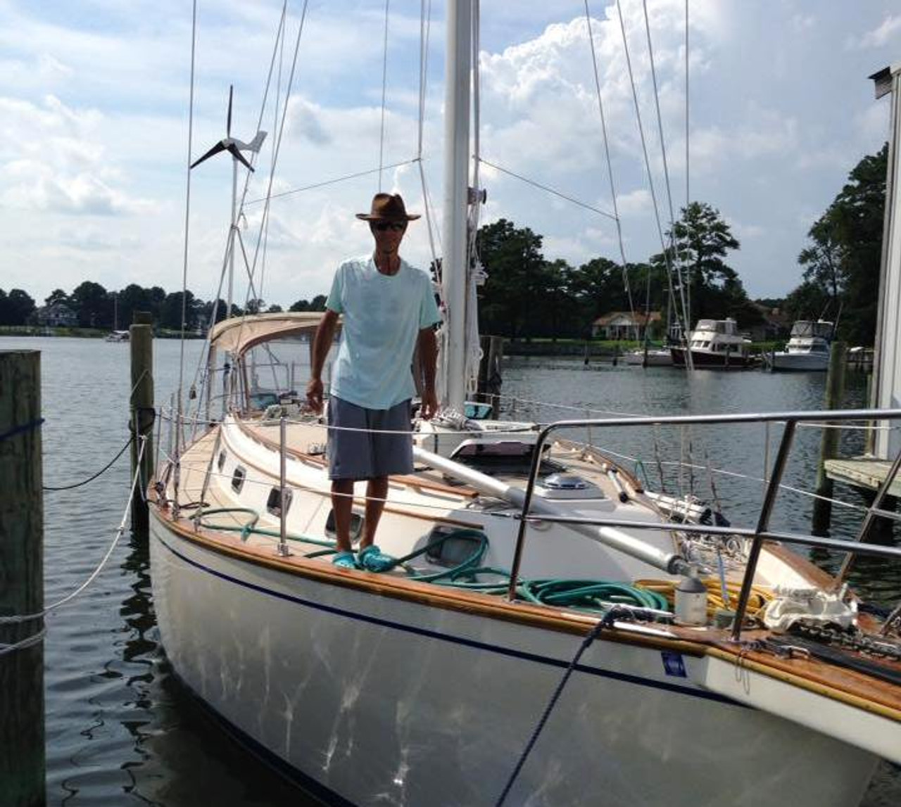 "Alain Gimenez aboard his MK4+ equipped sloop ""Holiday"""