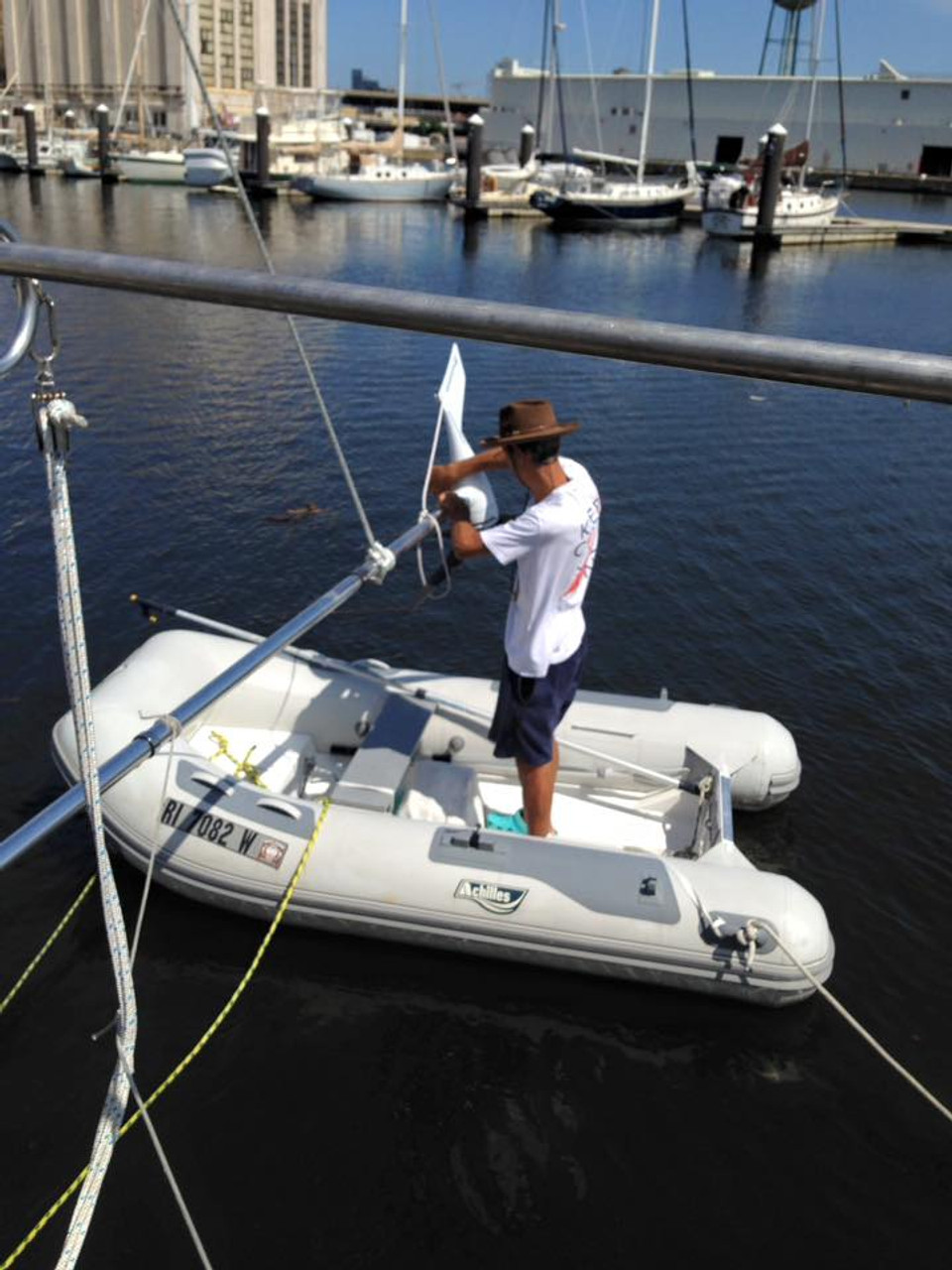 Pivoting pole kit mounted on the transom allows access to wind generator from the dinghy or dock.  (Courtesy of Mitzi and Alain Gimenez on S/V Holiday)