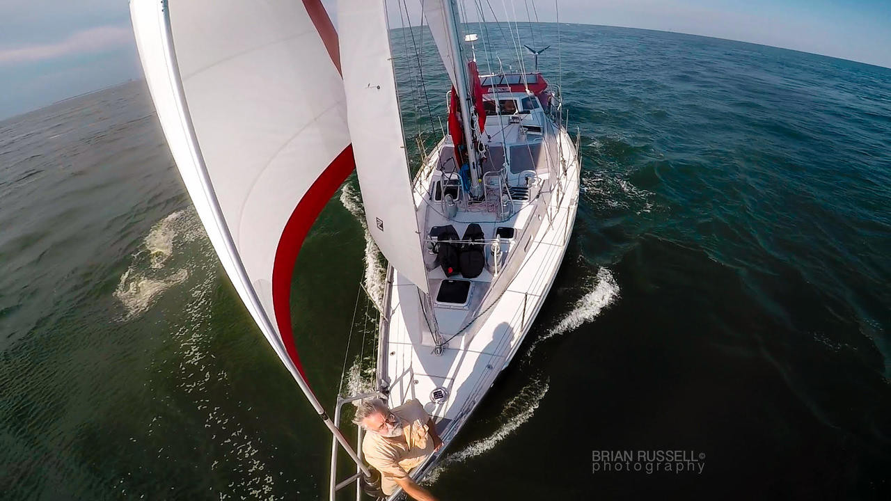 Marine Kinetix MK4+ customers Brian & Helen Russell in perfect sailing trim aboard their Dix 43 aluminum pilothouse cutter Helacious