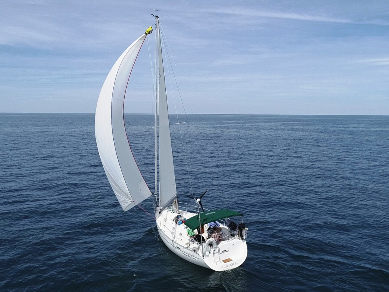 "Dan Ratko headed ""out-there"" with his MK4+ , and a perfect spinnaker set in his  2000 Beneteau 331 ""Strategic Rum Reserve"""
