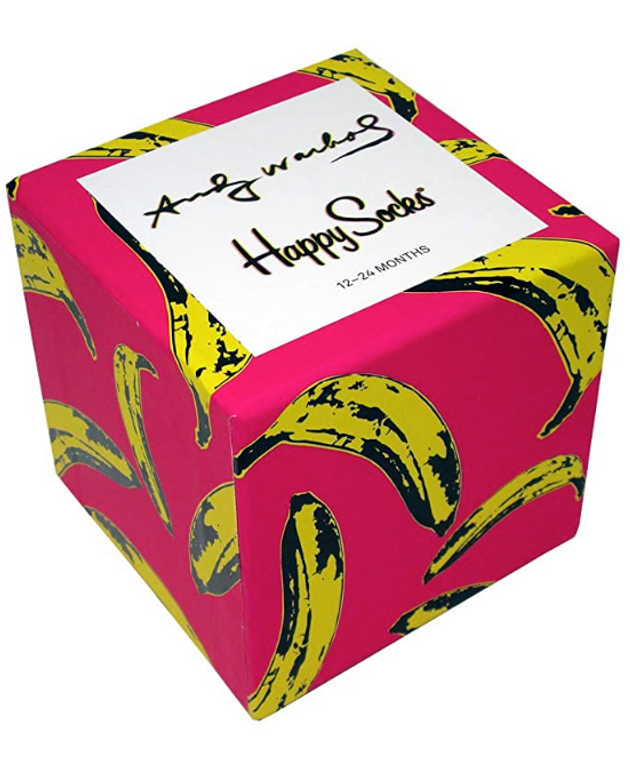 square box with pink background and yellow bananas