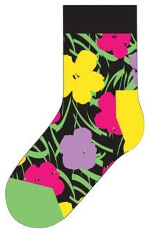 Flat image of kid sock with black background and pink, purple and yellow flowers.