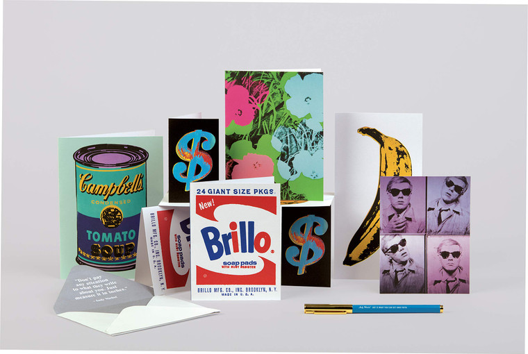 A selection of notecards standing upright featuring Warhol artworks