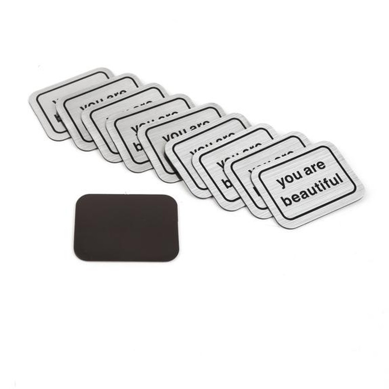 """10 silver magnets laid out with print that says """"you are beautiful"""""""